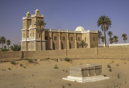 Tomb of Charles de Foucauld with church in background in El Ménia, Algeria