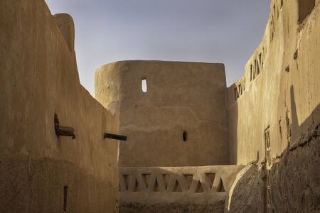 Ksour Taghit, fortified village in oasis of Sahara desert with traditional mud-brick architecture, Algeria
