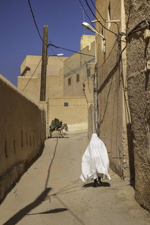 Muslim woman on the street of El Atteuf, one of the five cities making up what is referred to as the M'Zab Pentapolis, Algeria