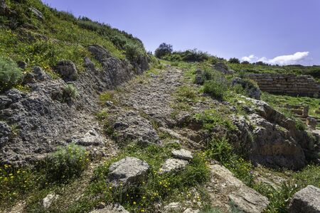 Roman road and entrance to ancient town Aptera, Crete, Greece