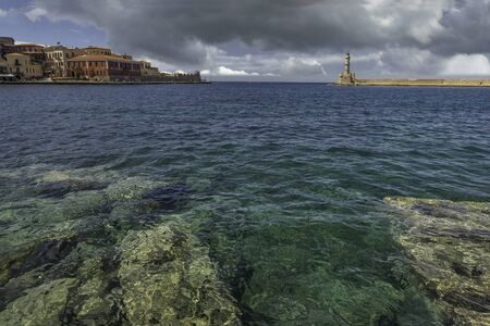 The bay of  Chania with rocks and lighthouse, Crete, Greece