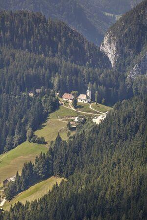 Sveti Duh (St. Spirit) under mountain Olseva with Kamnik-Savinja Alps in background, Slovenia