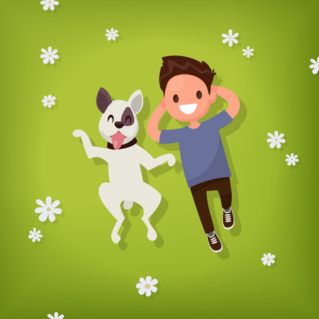 dog walking: Boy lies with the dog on the lawn. Vector illustration of a flat design