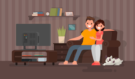 Young couple watching a movie. Man and woman sit on against the TV in the home atmosphere. Vector illustration in a flat style