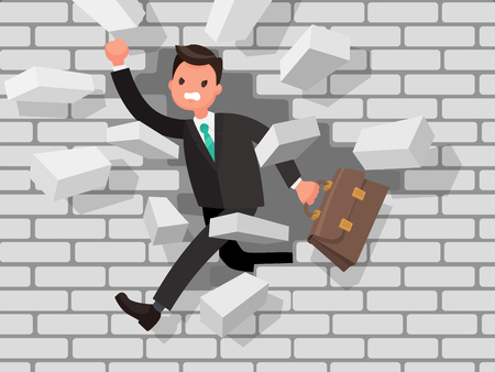 Man is breaking a wall. The concept of overcoming obstacles in business, strong will and motivation.