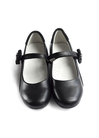 raiser: Front view on pair of black shoes for girl on white background