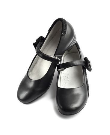 raiser: Pair of black shoes for girl on white background