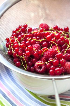 Fresh berries in a metal sieve