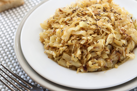 caraway: Fried cabbage with caraway and garlic on a plate