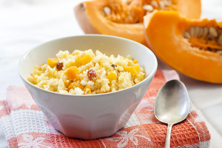 Sweet milky millet and rice porridge with pumpkin and raisins
