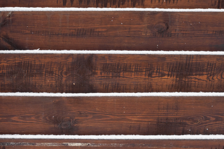Wooden fence background with snow lying on the boards 写真素材