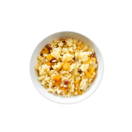 Sweet milky millet and rice porridge with pumpkin and raisins in bowl isolated on white background with clipping path. Flat lay, top, view