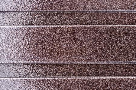 Brown hammer paint (also known as hammertone) background 版權商用圖片
