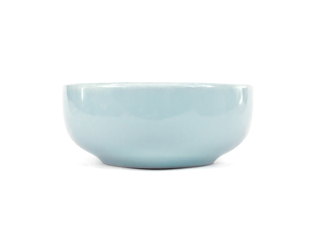 Blue ceramic bowl isolated on white background with clipping path