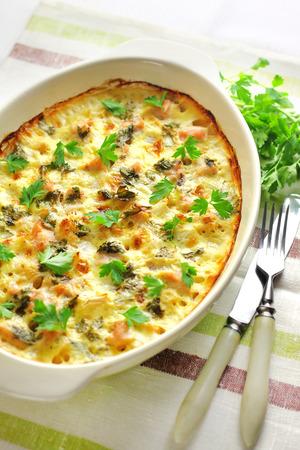 Chicken breast and cauliflower casserole in ceramic baking dish