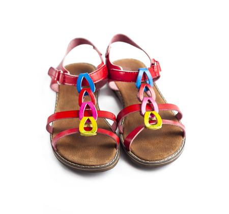 Pair of colorful female sandals isolated on white background