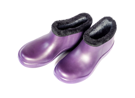 Purple rubber insulated galoshes isolated on white background