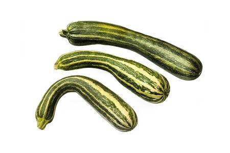 Group of fresh striped zucchini isolated on white background