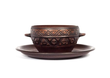 Brown ceramic rustic bowl and a plate isolated on white background