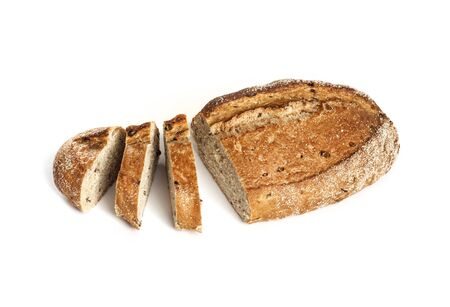 Loaf of whole wheat bread with slices isolated on white background