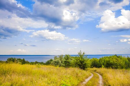 Beautiful landscape of Kaniv Reservoir shore, Ukraine, in sunny day with bright cloudy sky 版權商用圖片