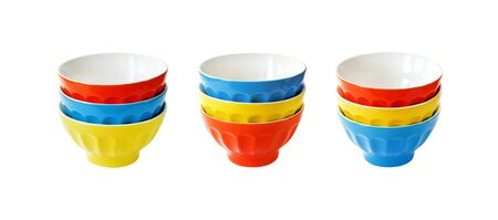 Stacked colorful ceramic bowls isolated on white background