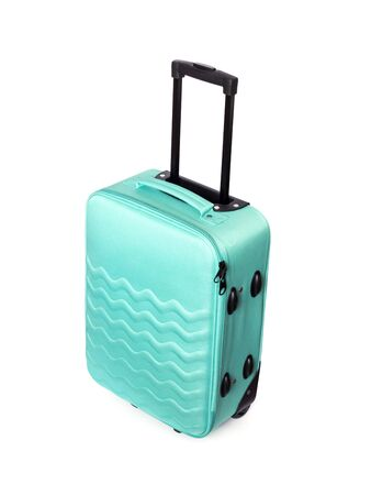 Bright turquoise textile travel suitcase with wavy pattern isolated on white background