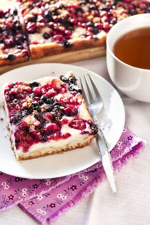 Tasty breakfast. Delicious pie with assorted berries and cottage cheese and a cup of tea Stock Photo