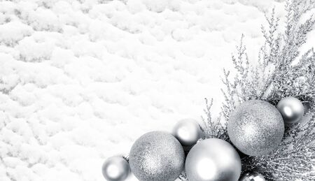 Christmas composition with silver balls on snow background. Christmas, new year concept. Flat lay, top view, copy space