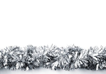 Christmas decoration. Silver garland on white background. Christmas, New year decorative element Фото со стока