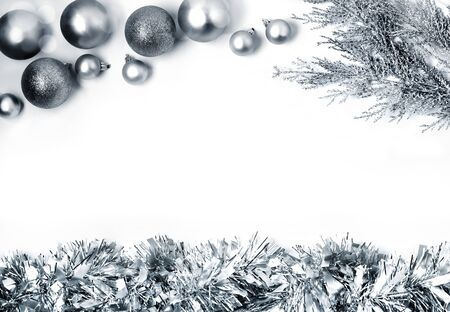 Christmas composition with silver balls on white background. Christmas, new year concept. Flat lay, top view, copy space Фото со стока
