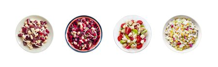 Collage of plates with various salads isolated on white background. Top view, flat lay Фото со стока