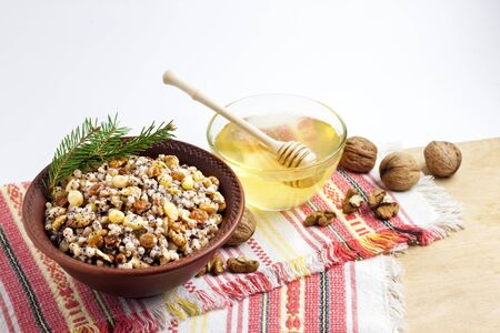 Kutia or kutya is a ceremonial grain dish with sweet gravy traditionally served by Eastern Orthodox Christians in Ukraine, Belarus and Russia during the Christmas - Feast of Jordan holiday season and as part of a funeral feast. Copy space
