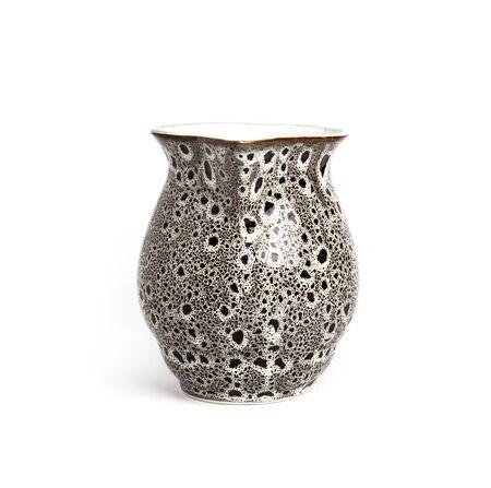 Glazed ceramic milk jar isolated on a white background
