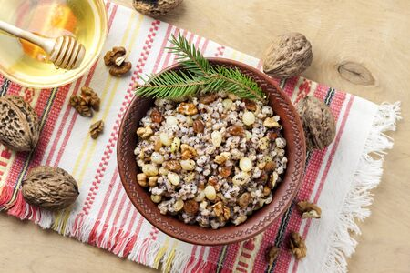 Kutia or kutya is a ceremonial grain dish with sweet gravy traditionally served by Eastern Orthodox Christians in Ukraine, Belarus and Russia during the Christmas - Feast of Jordan holiday season and as part of a funeral feast. Flat lay, top view