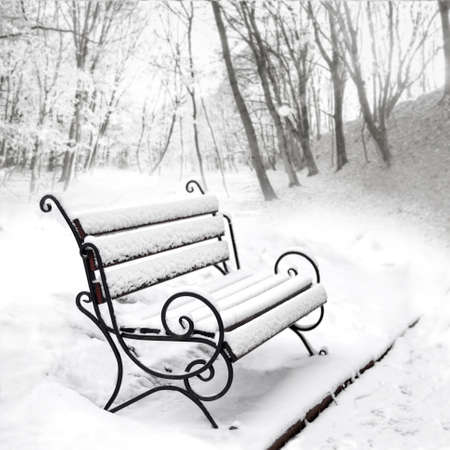 Winter has come. Single empty bench covered with snow in a winter park. Copy space Stock fotó