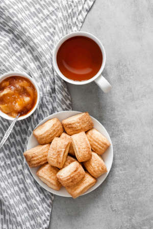 Tasty breakfast. Homemade sweet cinnamon cookies, cup of tea and apple confiture. Flat lay, top view, copy space Stock fotó