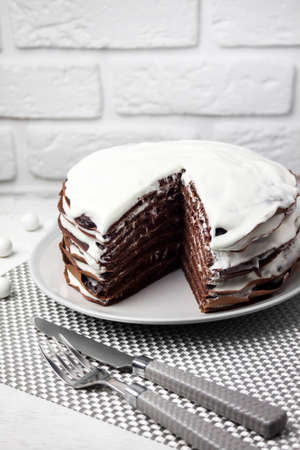 Homemade chocolate cake with cream. Slice of cake is cut off Stock fotó