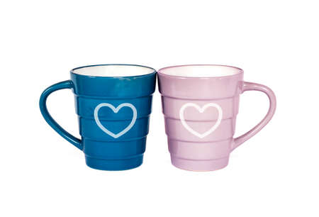 Two mugs with hearts drawn isolated on white background with clipping path