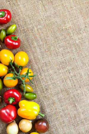 Assortment of colorful fresh vegetables on sackcloth background. Flat lay, top view. Copy space. 版權商用圖片