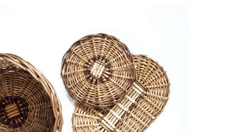 Wicker basket and bottoms for baskets isolated on whote background. Flat lay. Weaving from a vine concept. 版權商用圖片