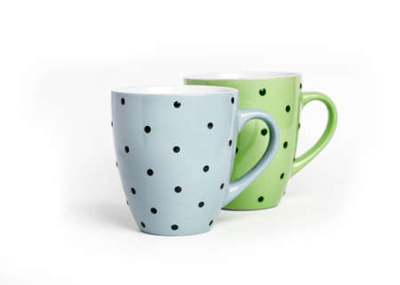 Two dotted mugs isolated on white background with copy space 版權商用圖片