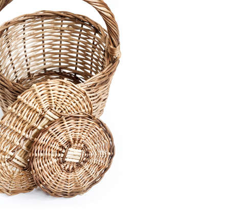 Wicker basket and bottoms for baskets isolated on white background. Flat lay. Weaving from a vine concept. 版權商用圖片