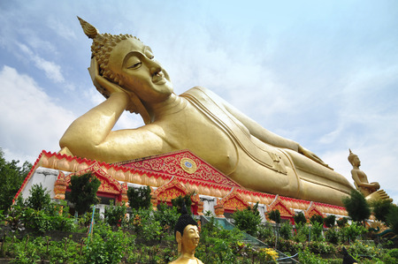 reclining: The great Reclining Buddha in the temple Chiangmai Thailand