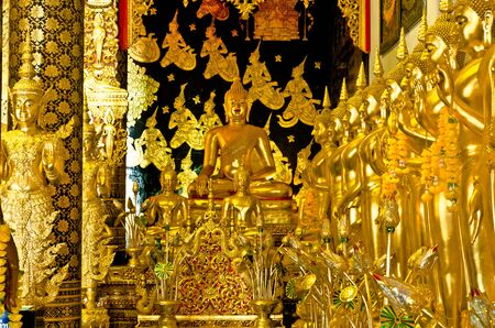 supernatural power: Golden buddha statue in buddhism temple thailand