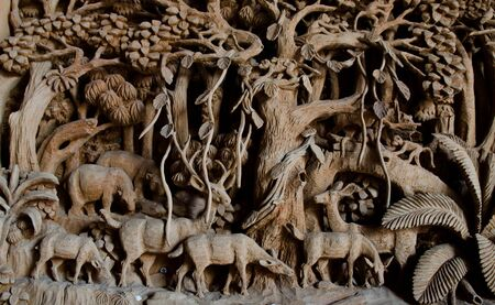 wood craft: Public Hand Carved deer Wood Craft at the temple Stock Photo