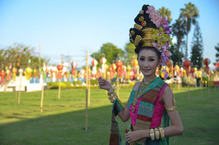 lady with the lamp: Beautiful Thai lady in Thai traditional background Thai lamp