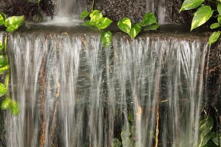 Waterfall in Japanese style garden  Stock Photo