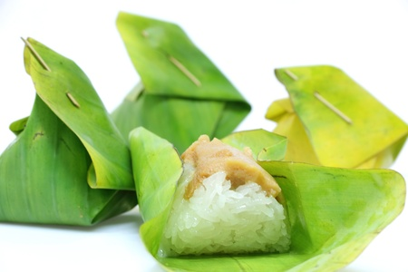 Thai dessert, Sticky rice with steamed custard, wrapped in banana leaves. Stock Photo