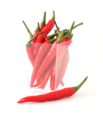 Red chillies on white background